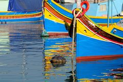 Fishing boats. Traditional Maltese fishing boats with reflection Royalty Free Stock Images