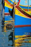 Fishing boats. Traditional Maltese fishing boats with reflection Stock Image
