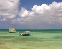 Fishing Boats. Two small fishing boats in a lagoon Royalty Free Stock Images