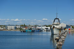 Fishing Boats. Some trawlers as part of the fishing fleet in Fremantle, Western Australia, are anchoring in the secure harbour Royalty Free Stock Photography