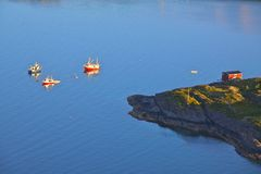 Fishing boats. Seen from a cliff near Henningsvaer, Lofoten, Norway Stock Image