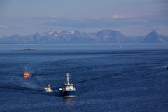 Fishing boats. Returning to port in Henningsvaer on Lofoten Islands, Norway Stock Photo