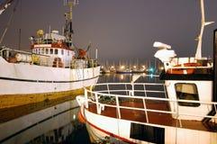 Fishing boats. At night in Norwegian harbor Royalty Free Stock Image