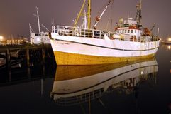 Fishing boats. At night in Norwegian harbor Royalty Free Stock Photography