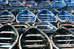 Fishing Boats. Rows of neatly tied up fishing boats in blue and gray, taken in Agadir, Morocco Royalty Free Stock Photos