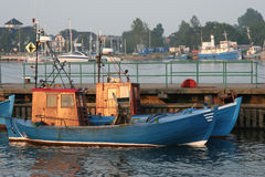 Fishing boats. In a harbour Stock Photos
