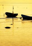 Fishing boats. Anchored fishing boats in sunset light Royalty Free Stock Images