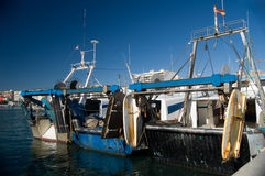 Fishing boats. In port, ready to start Stock Photos
