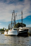 Fishing Boats. Moored side by side in a channel Royalty Free Stock Image