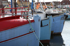 Fishing Boats aAt Harbour. Fishing boats Lined Up Side By Side Royalty Free Stock Image
