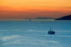 Fishing boats at anchor. Panorama of Marina Bay with two ships at sunset Royalty Free Stock Photos