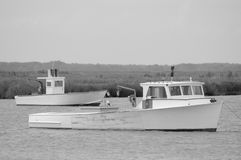Fishing boats at anchor. A black and white photograph of fishing boats moored in the Delaware Bay royalty free stock photo