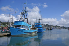 Fishing boats at anchor in marina in Yaquina Bay Royalty Free Stock Photo
