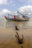 Fishing boats and  anchor at shore-line Stock Photos