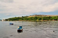 Fishing boats at anchorage near the Malecon waterfront, view of the sea strait, walls of the fortress of San Carlos de la Cabania. Fishing boats at anchorage Stock Photos
