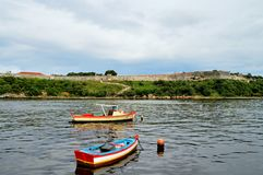 Fishing boats at anchorage near the Malecon waterfront, view of the sea strait, walls of the fortress of San Carlos de la CabaniaC. Fishing boats at anchorage Royalty Free Stock Photo