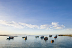 Fishing boats anchored in the harbor. Small fishing boats anchored in the harbor just before sunset on a quiet afternoon Stock Photography
