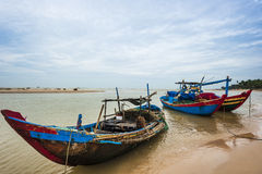 The fishing boats anchored near the seaside Stock Images