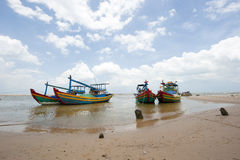 Fishing boats anchored near the seaside Stock Photos