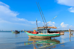 Fishing boats anchored near the shore Stock Photo