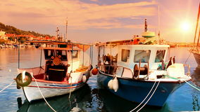 Fishing boats anchored in a peaceful Mediterranean port. At the sunset,video clip stock video