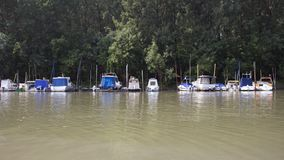 Fishing Boats Anchored at Rivers Shore stock images