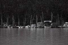 Fishing Boats Anchored at Rivers Shore stock image