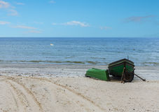 Fishing boats anchored on sandy Beach of the Baltic Sea Royalty Free Stock Photo