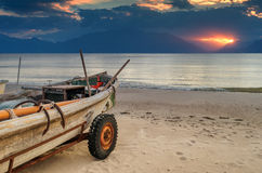 Fishing boats anchored at sandy beach Royalty Free Stock Images