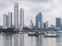Fishing boats anchored with skyscrapers in Panama Stock Photography
