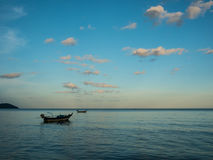 Fishing boats anchoring on the sea near by beach in sunset. At south of Thailand Royalty Free Stock Photos