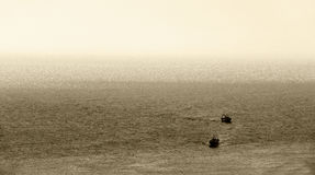 Fishing boats, back to the harbour, sepia hue Stock Photo
