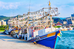 Fishing boats in Badouzi fishing port. KEELUNG, TAIWAN - APRIL 04: View of large fishing boats in Badouzi fishing village in the countryside of Keelung on April Royalty Free Stock Photos