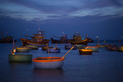 Fishing boats and baskets at sunset Stock Image