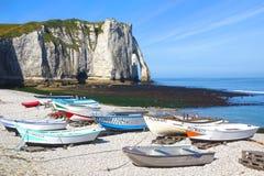 Fishing boats on a bay beach Cote d'Albatre. Stock Photos