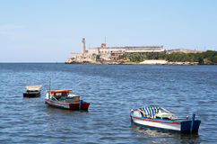 Fishing boats in the bay of Havana. With El Morro in the background Stock Image