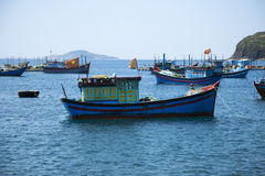 Fishing boats in the Bay near the shore Stock Photos