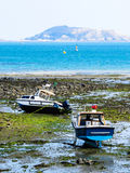 Fishing boats in a bay during outflow Stock Images