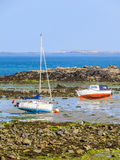 Fishing boats in a bay during outflow royalty free stock photo