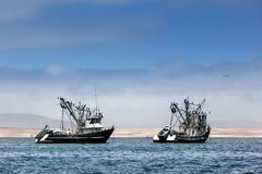 Fishing boats in bay Royalty Free Stock Image