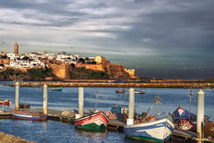 Fishing boats in the bay of the Pacific Ocean (Morocco, Sali), against the background of the old fortress stock image