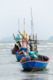 Fishing boats at bay in rainy day. Royalty Free Stock Image