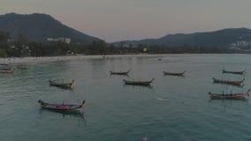 Fishing boats in the bay, schooner, sea, thai, thailand, yacht, sunset, beach, ship, drone flight 4k. Fishing boats in the blue water bay, schooner, sea, thai stock video footage