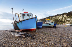 Fishing Boats on the Beach. At Beer on the Jurassic Coast in Devon Stock Photos