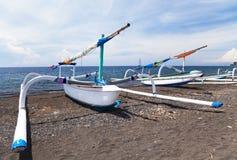 Fishing Boats on Beach, Amed, Bali, Indonesia. Traditional fishing boats at Amed Beach, Bali, Indonesia Stock Photo