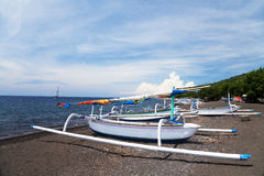 Fishing Boats on Beach, Amed, Bali, Indonesia. Traditional fishing boats at Amed Beach, Bali, Indonesia Royalty Free Stock Photos