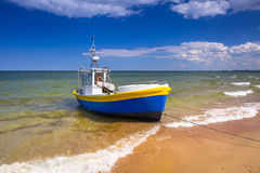Fishing boats on the beach of Baltic Sea. In Poland Stock Images