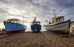 Fishing Boats on the Beach at Beer in Devon. Fishing Boats on the beach at Beer on the Jurassic Coast in Devon Royalty Free Stock Photo