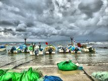Fishing boats on the beach on a cloudy day Stock Photo