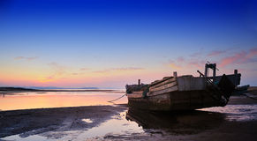 Fishing boats on the beach. Low tide, boats stranded on the beach Stock Images